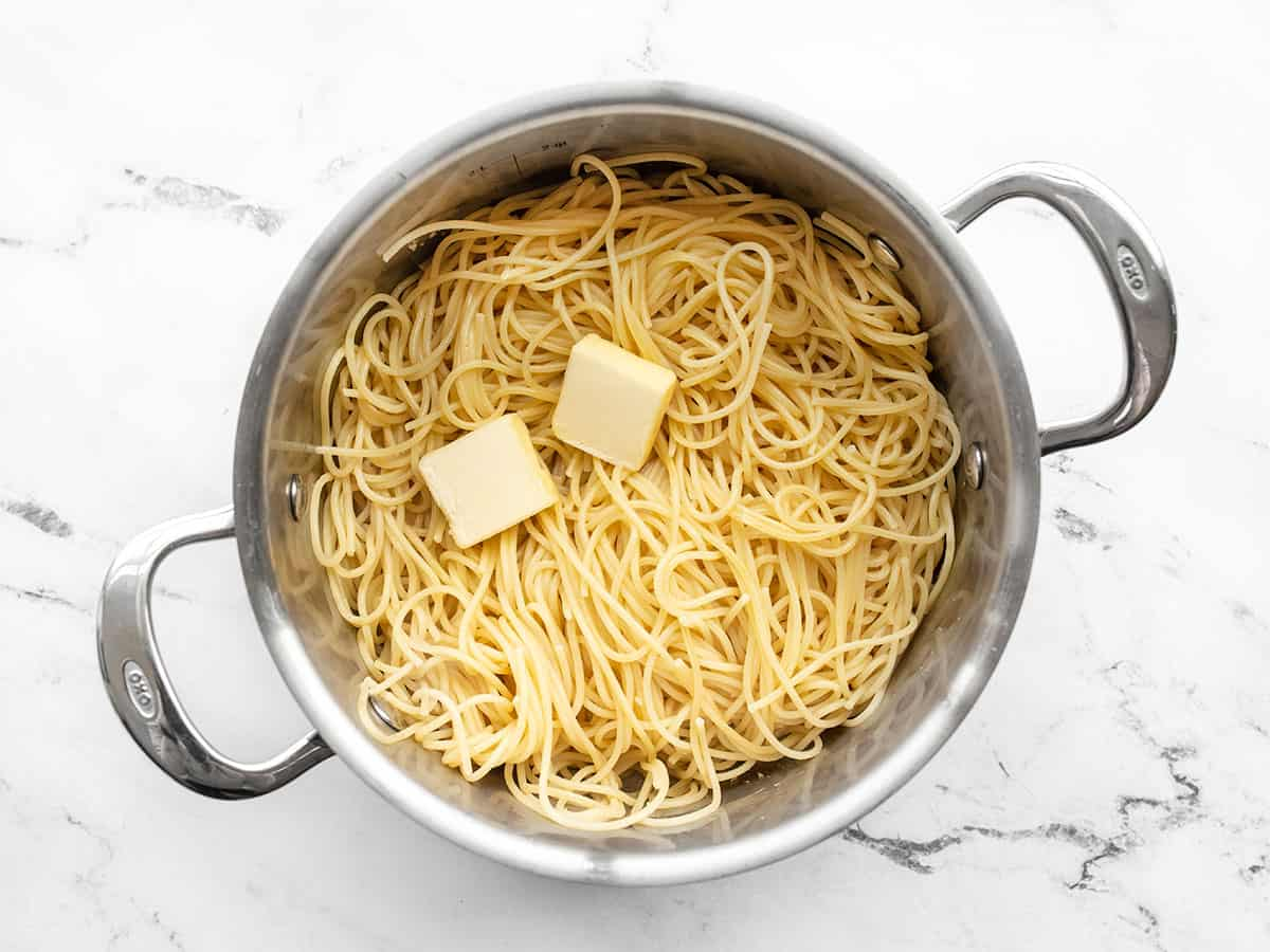 Drained pasta and butter added back to the pot.