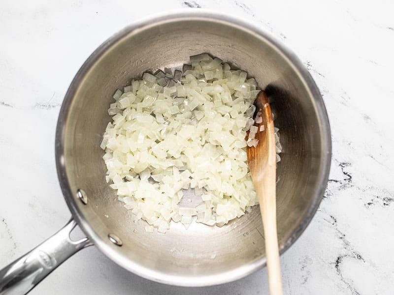 Sautéed onion in butter in sauce pot.