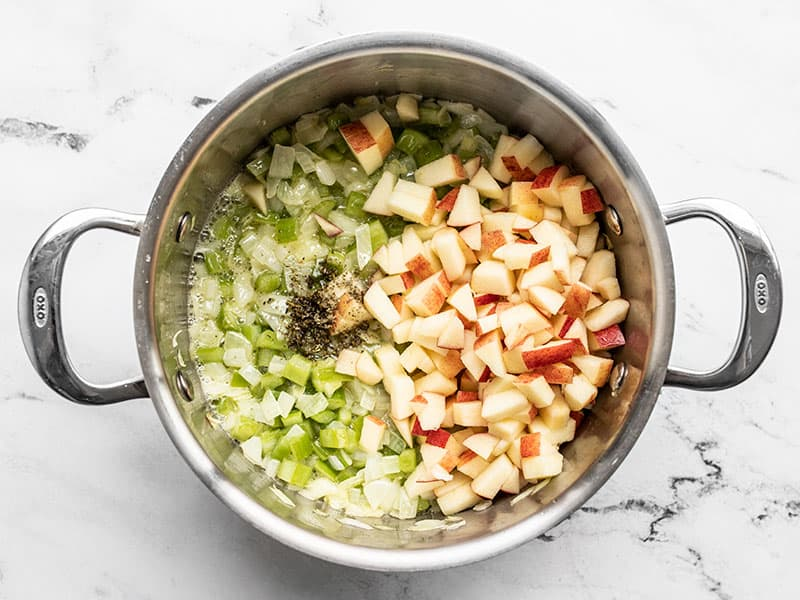 Add diced apples and sage to pot