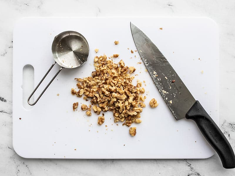 Chopped walnuts on a cutting board