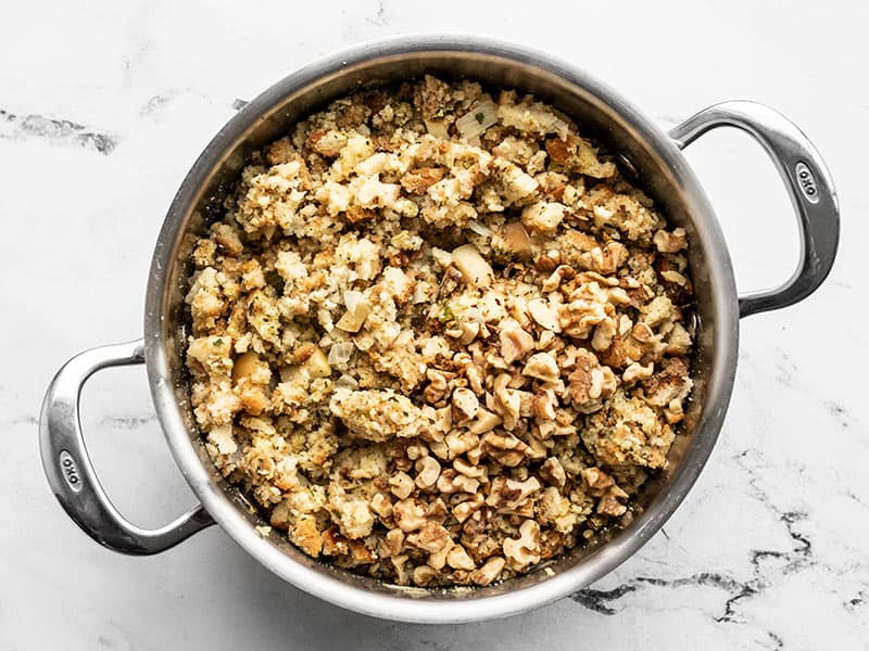 Chopped walnuts added to the pot with stuffing