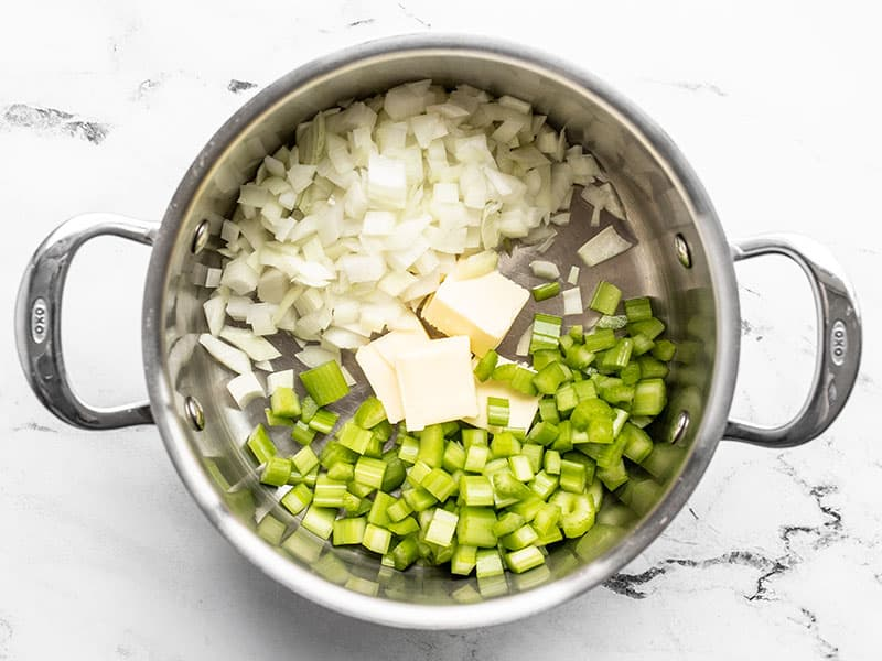 Diced onion, celery, and butter in a pot