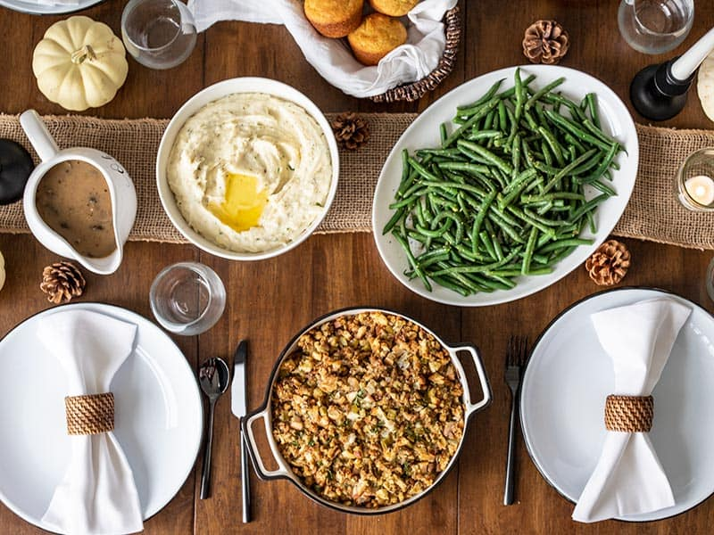 Thanksgiving side dishes on a dining table, from above