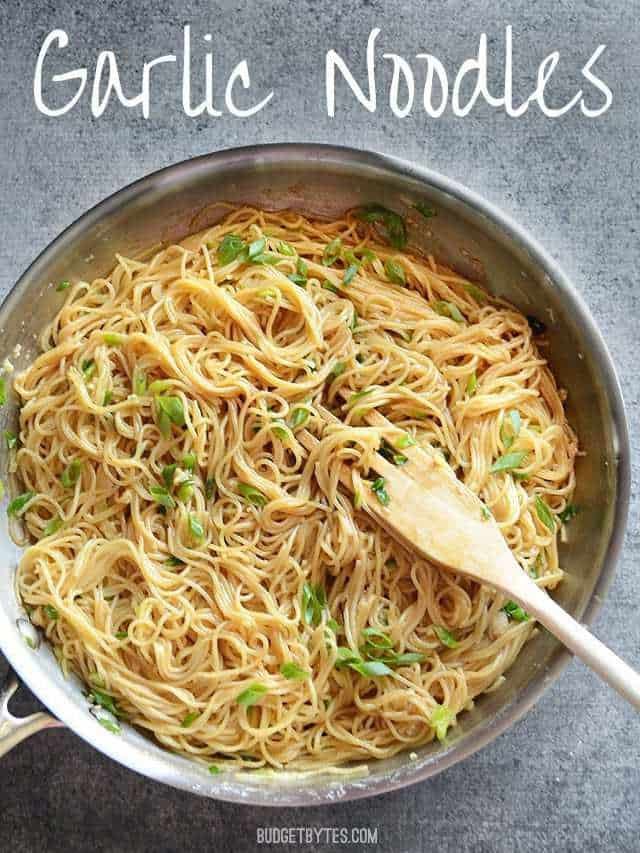 Garlic Noodles in the skillet topped with green onion