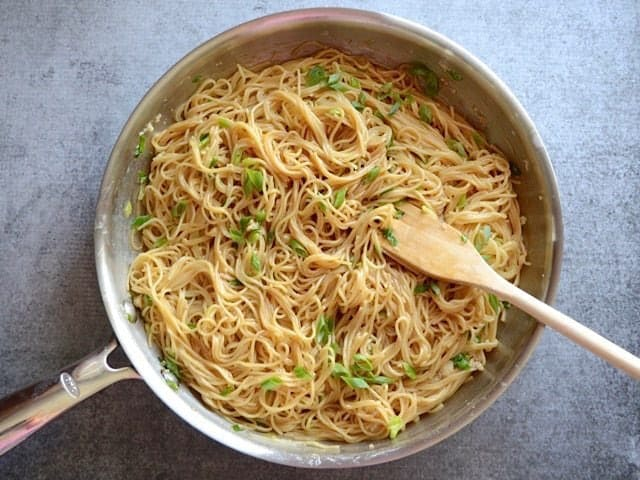 Mix Pasta and Sauce and top with green onion