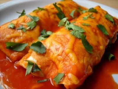 Two sweet potato enchiladas on a plate
