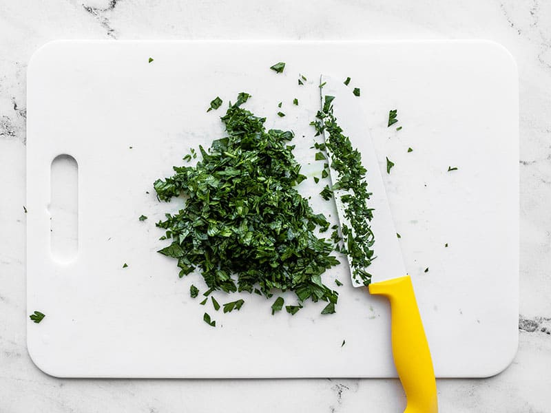 Chopped parsley on a cutting board