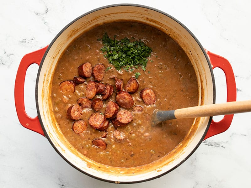 Andouille and parsley added to red beans