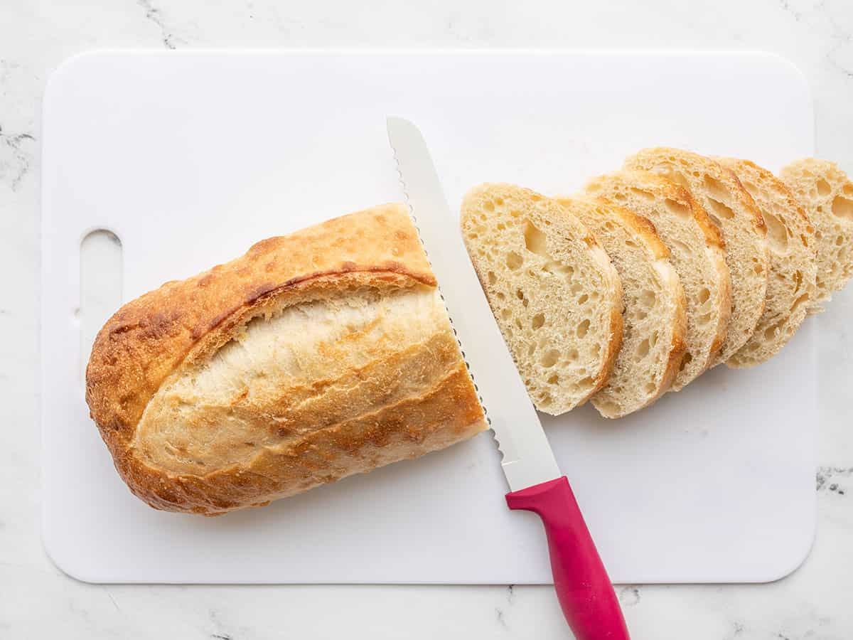 A loaf of bread being sliced