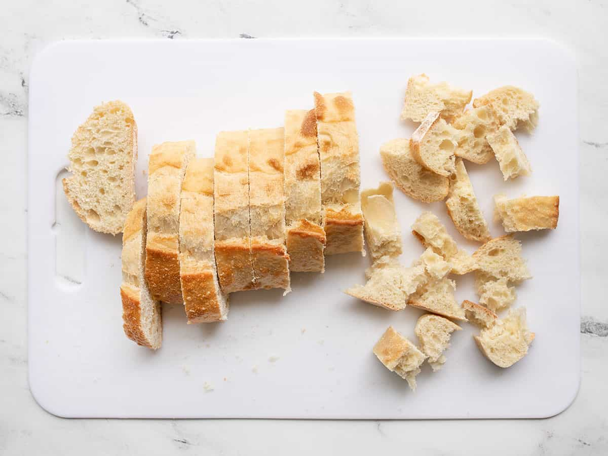 Bread being cut into squares