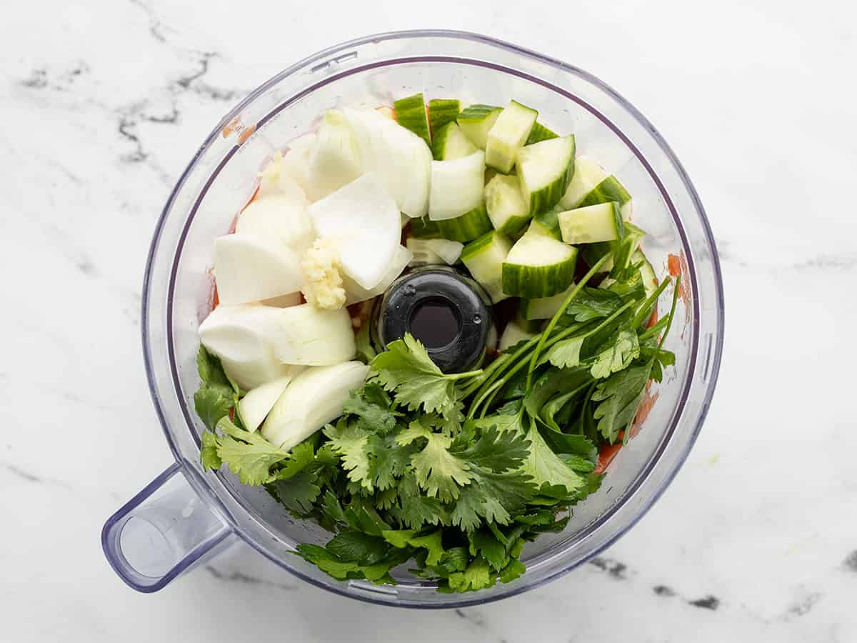 onion, cucumber, and herbs added to food processor