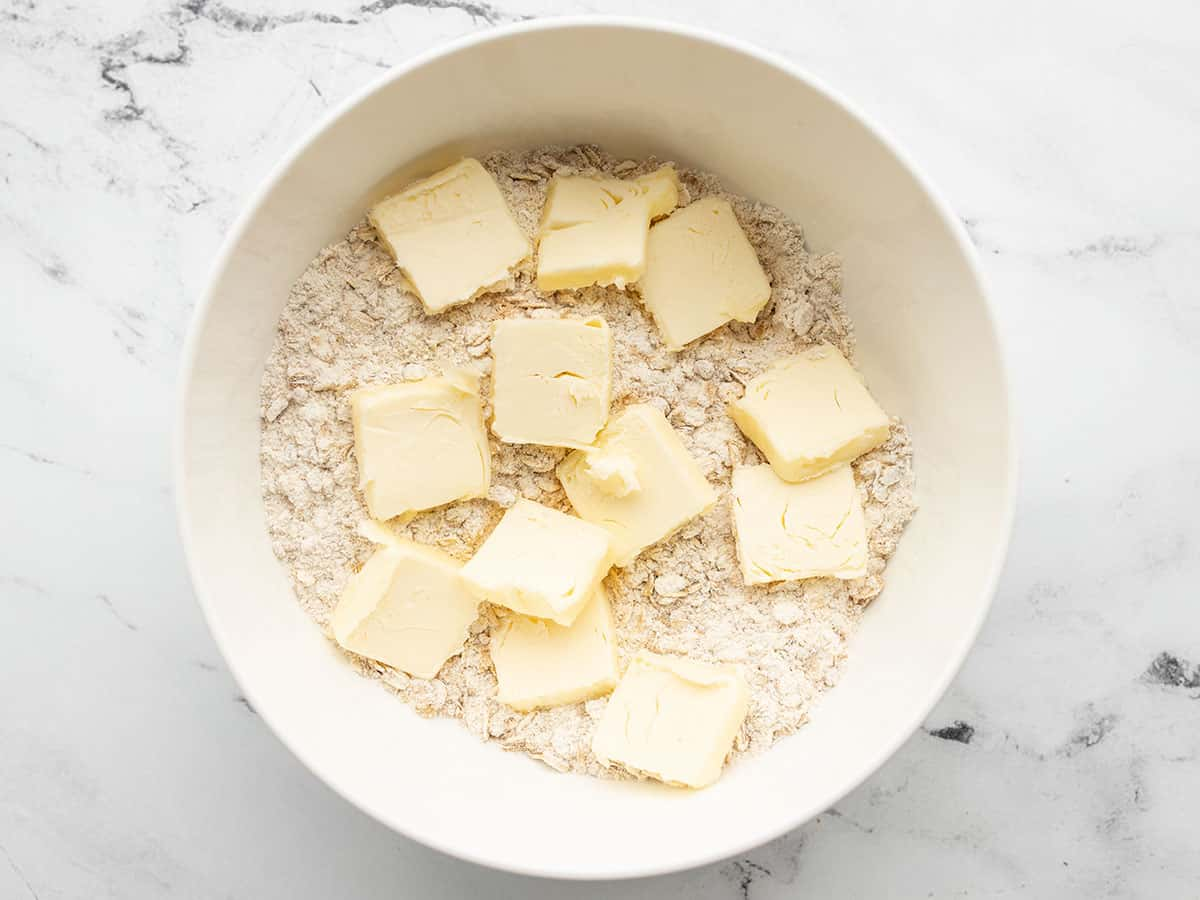 Butter added to the bowl with the dry ingredients