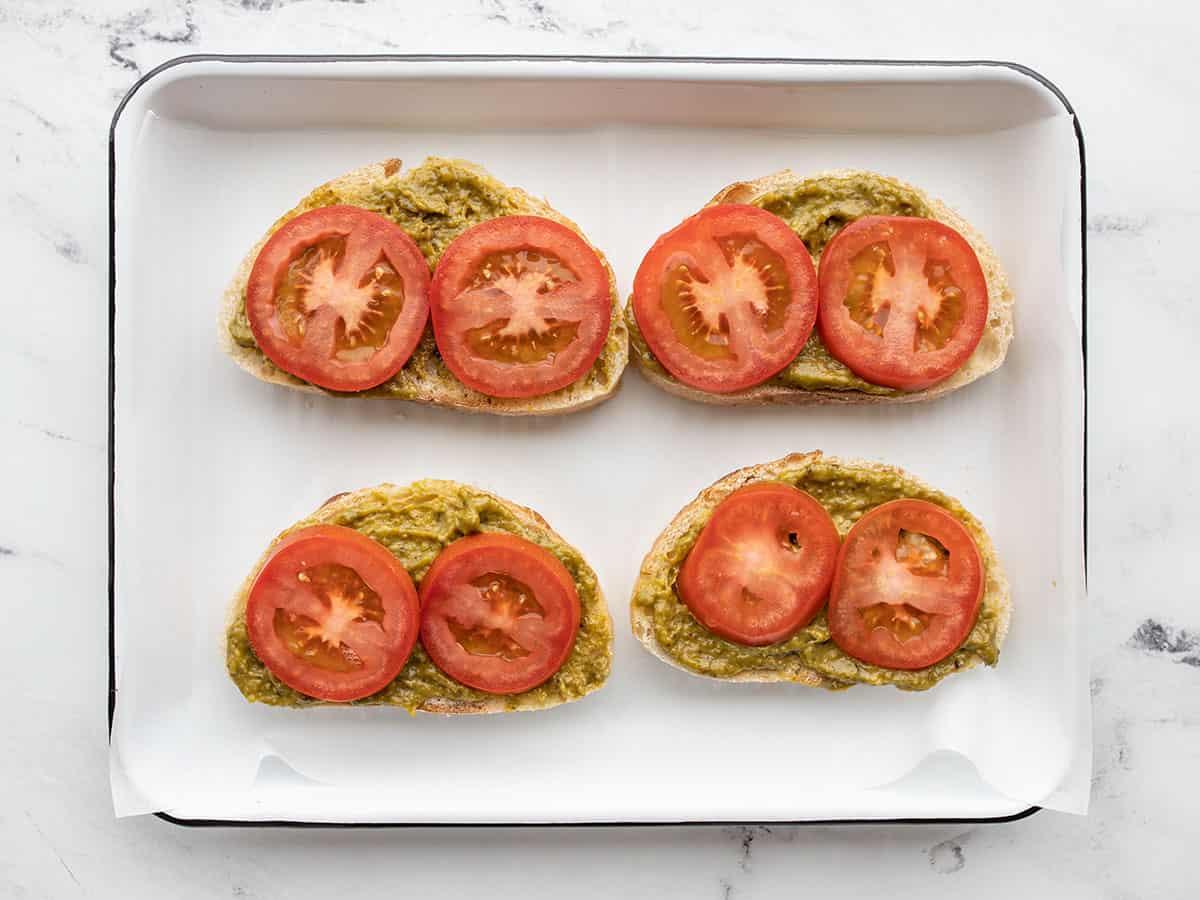 sliced tomatoes on pesto bread