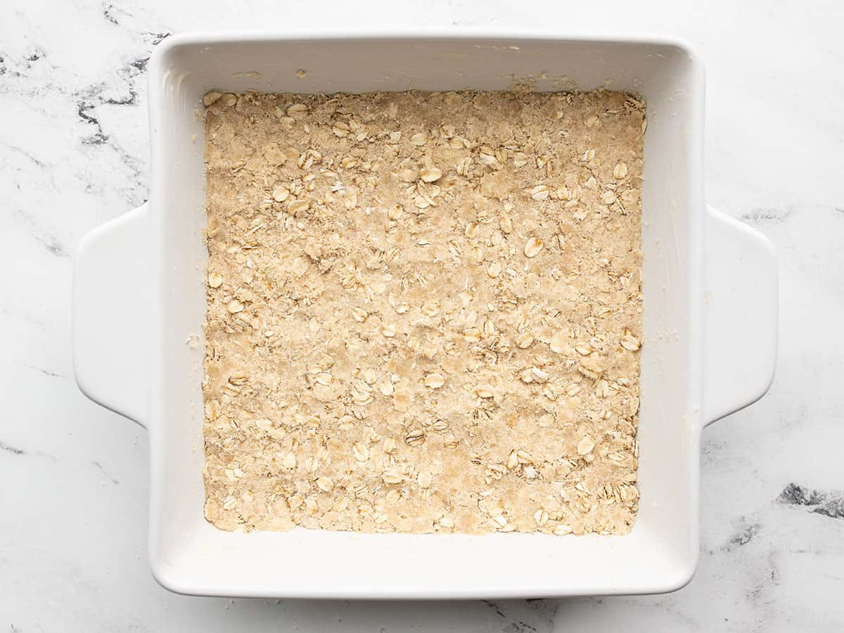 Oat mixture pressed into the bottom of the baking dish