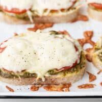 close up side view of pesto cheese toast on the baking sheet