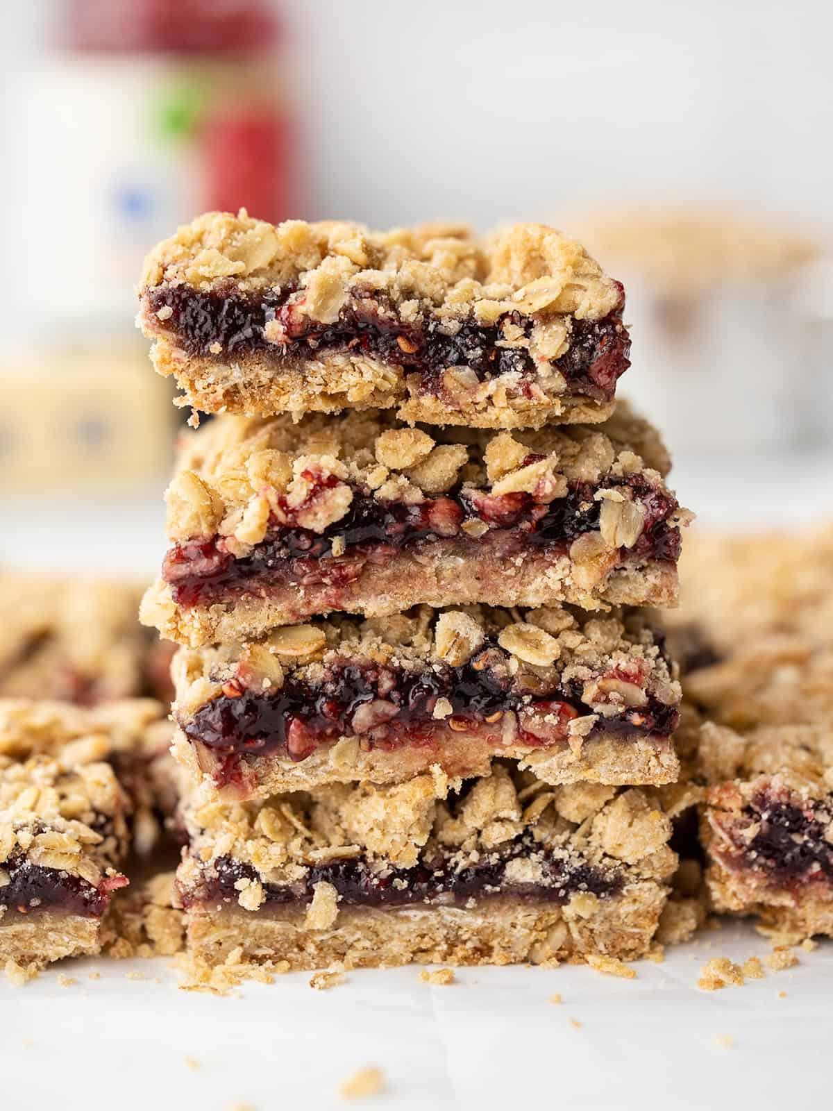 A stack of raspberry oatmeal bars viewed from the side