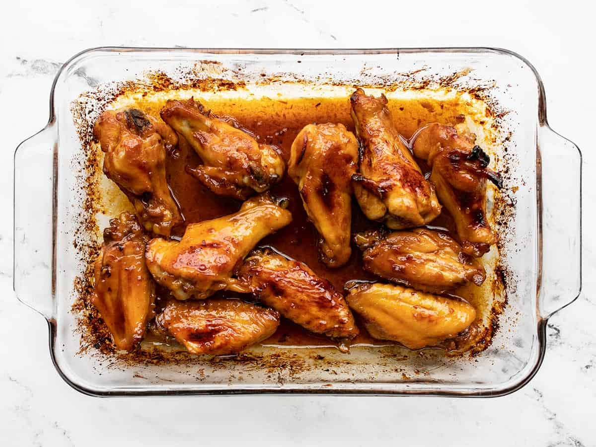 Finished sticky ginger chicken wings in the casserole dish