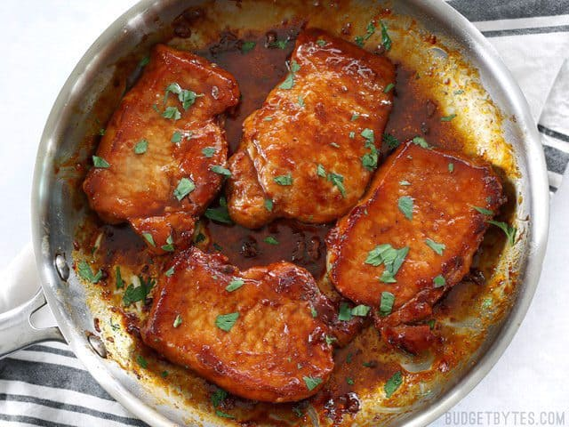 Tender juicy Glazed Pork Chops in the skillet