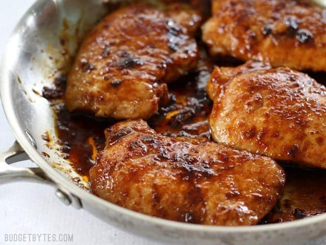Close up of tender juicy Glazed Pork Chops in the skillet.