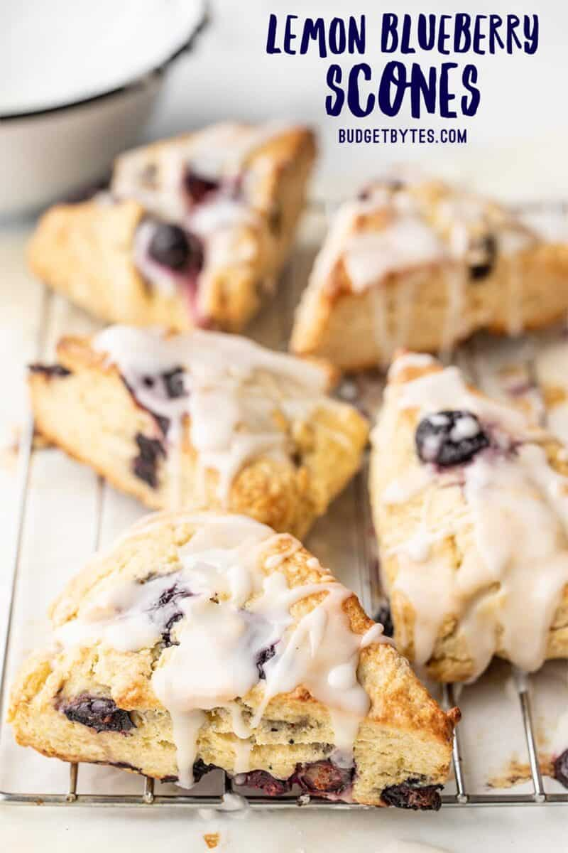 side view of lemon blueberry scones on a cooling rack, title text at the top