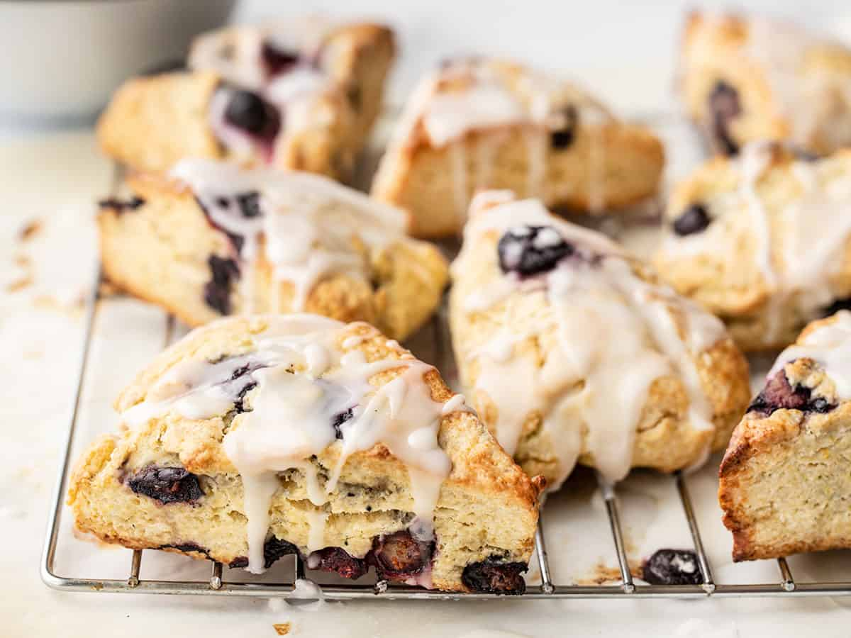 Side view of lemon blueberry scones on a wire cooling rack