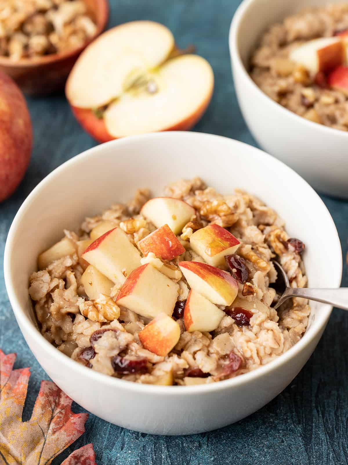 Side view of two bowls of autumn fruit and nut oatmeal
