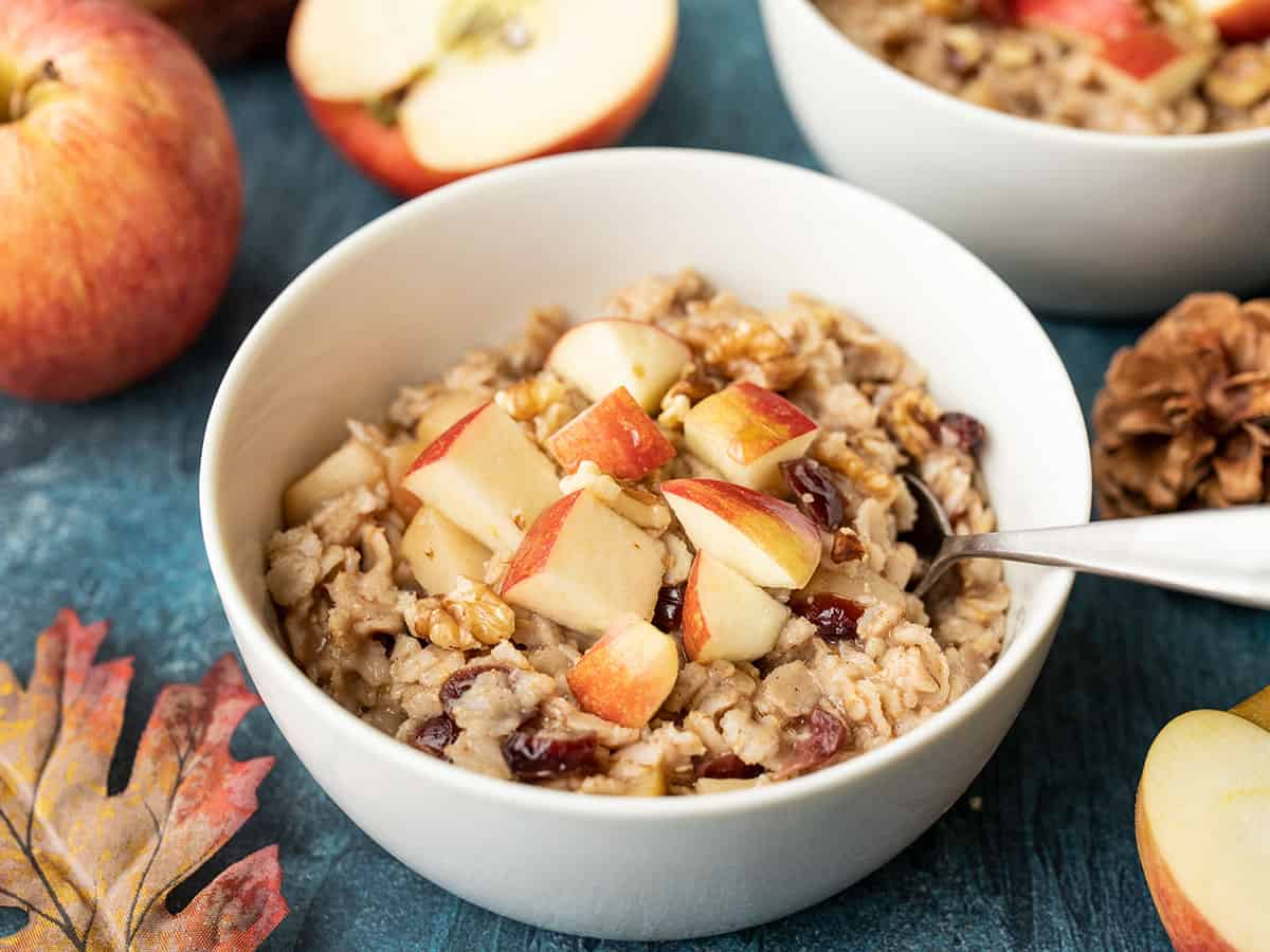 side view of a bowl of autumn fruit and nut oatmeal