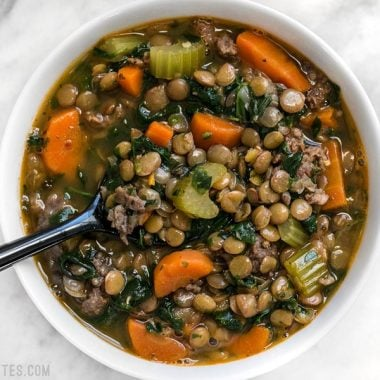 Lentil & Sausage Stew is a fast and easy soup bursting with flavor and chock full of good-for-you vegetables! Plus it freezes well for later. BudgetBytes.com