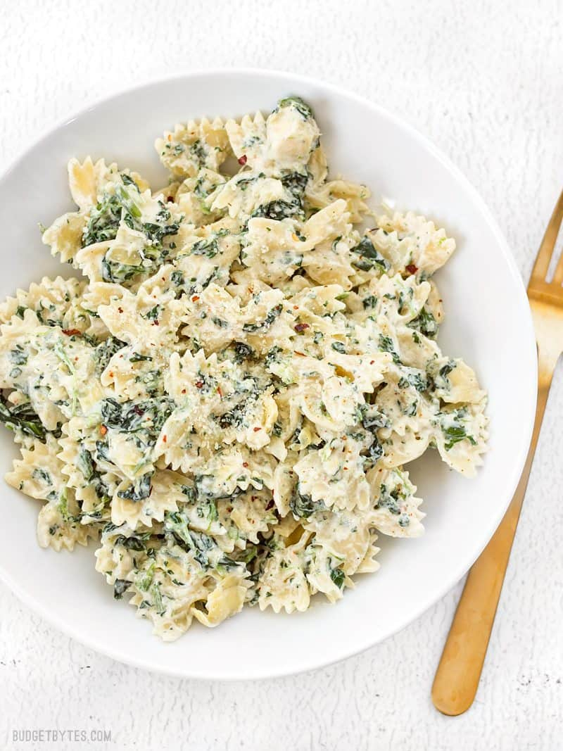 It's like having your favorite restaurant appetizer for dinner! Spinach artichoke pasta is filling, flavorful, and creamy! BudgetBytes.com