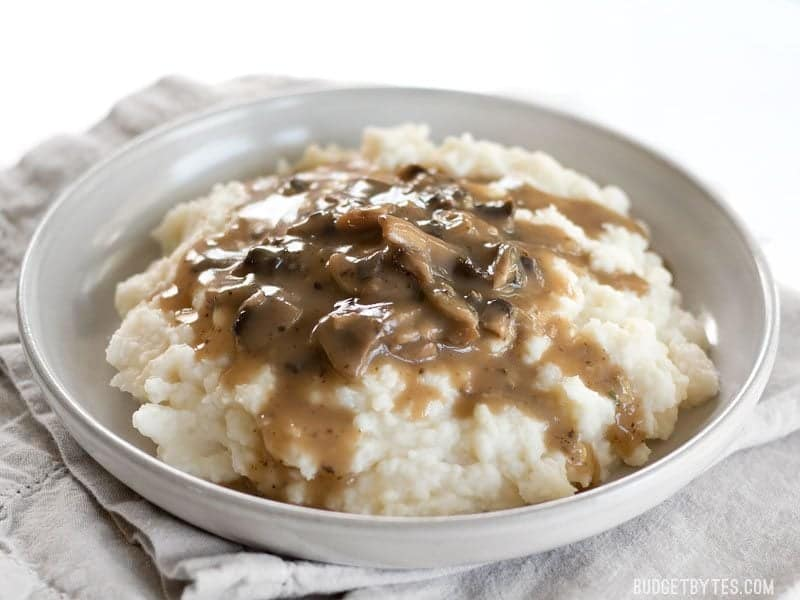 This one quick, easy, and insanely flavorful Mushroom Herb Gravy will satisfy both meat eaters and vegetarians alike. Step by step photos. BudgetBytes.com