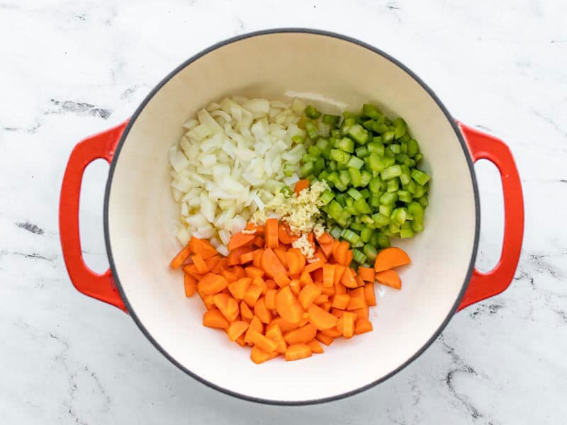 Chopped onion, celery, carrots, and minced garlic in the soup pot