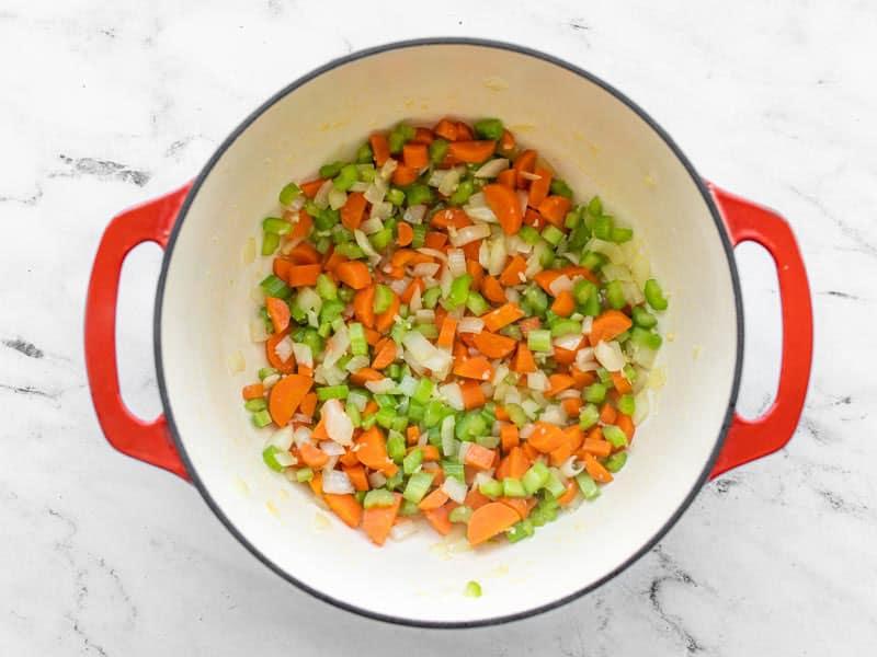 Sautéed vegetables in soup pot