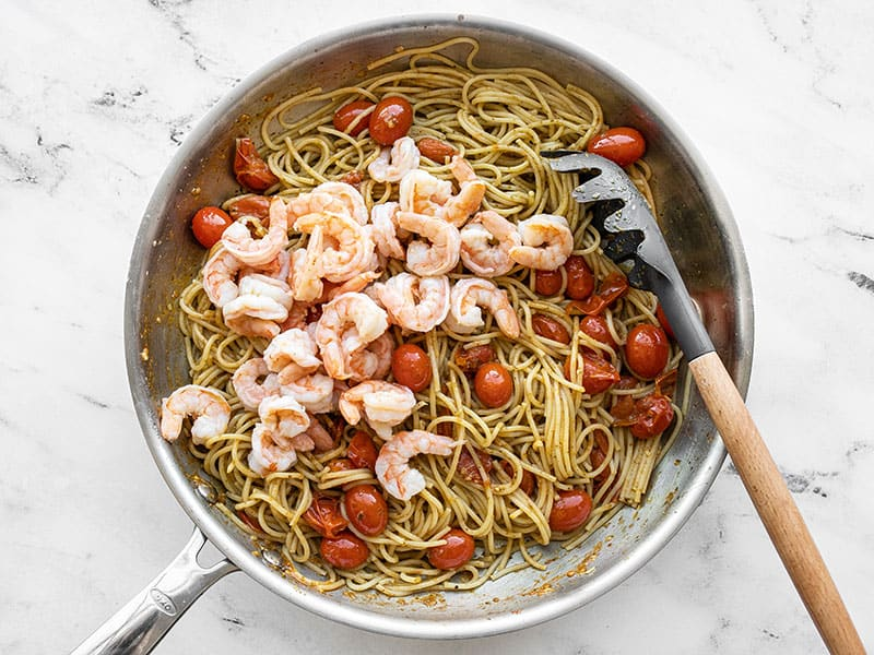 Cooked shrimp added to the pasta