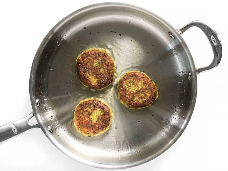 Top view of Three Falafel in pan frying