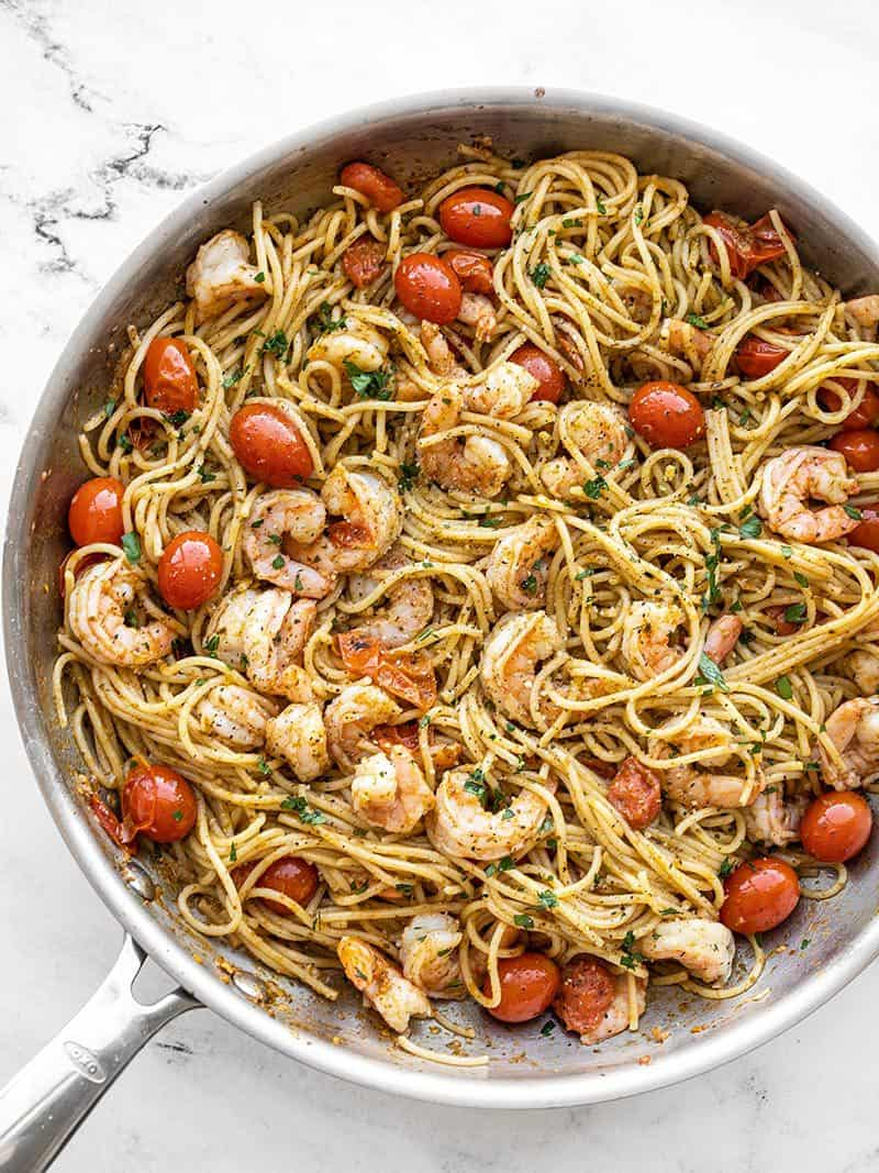 Overhead view of the skillet full of pesto shrimp pasta