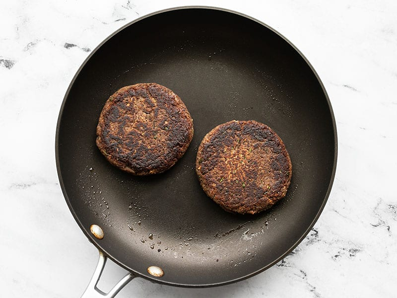 Black bean burgers in a skillet