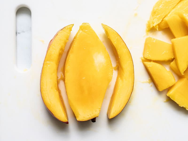 Remaining flesh cut off mango pit.