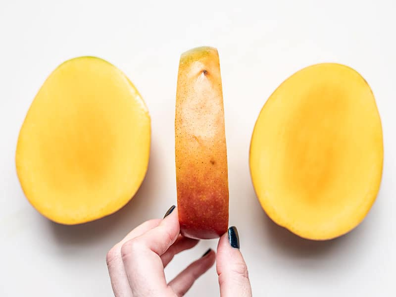 Mango with two cheeks cut off