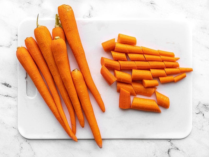 Peel and chopped carrots on a cutting board