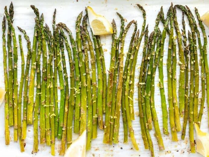 Close up overhead shot of lemon garlic roasted asparagus on the sheet pan