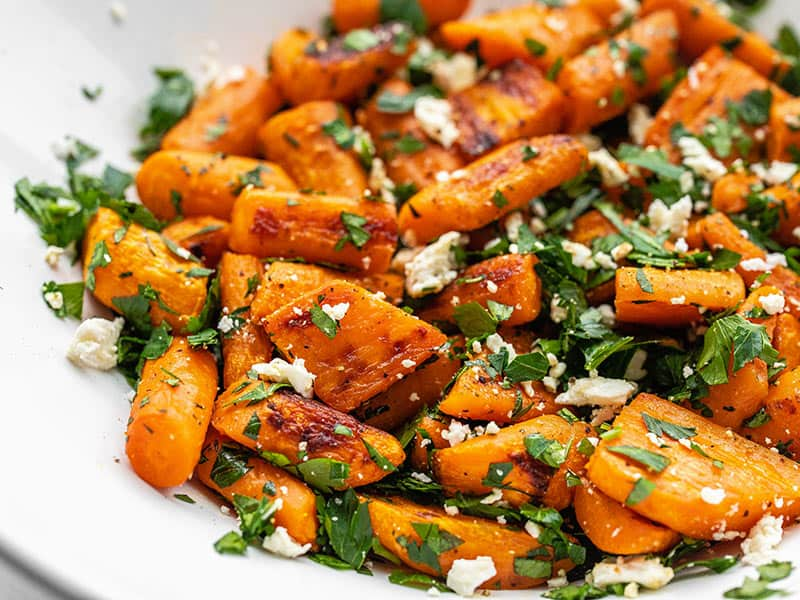 Close up side view of roasted carrot and feta salad