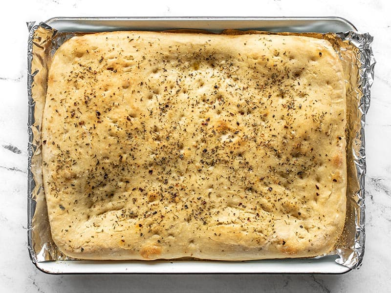 Baked focaccia on the baking sheet