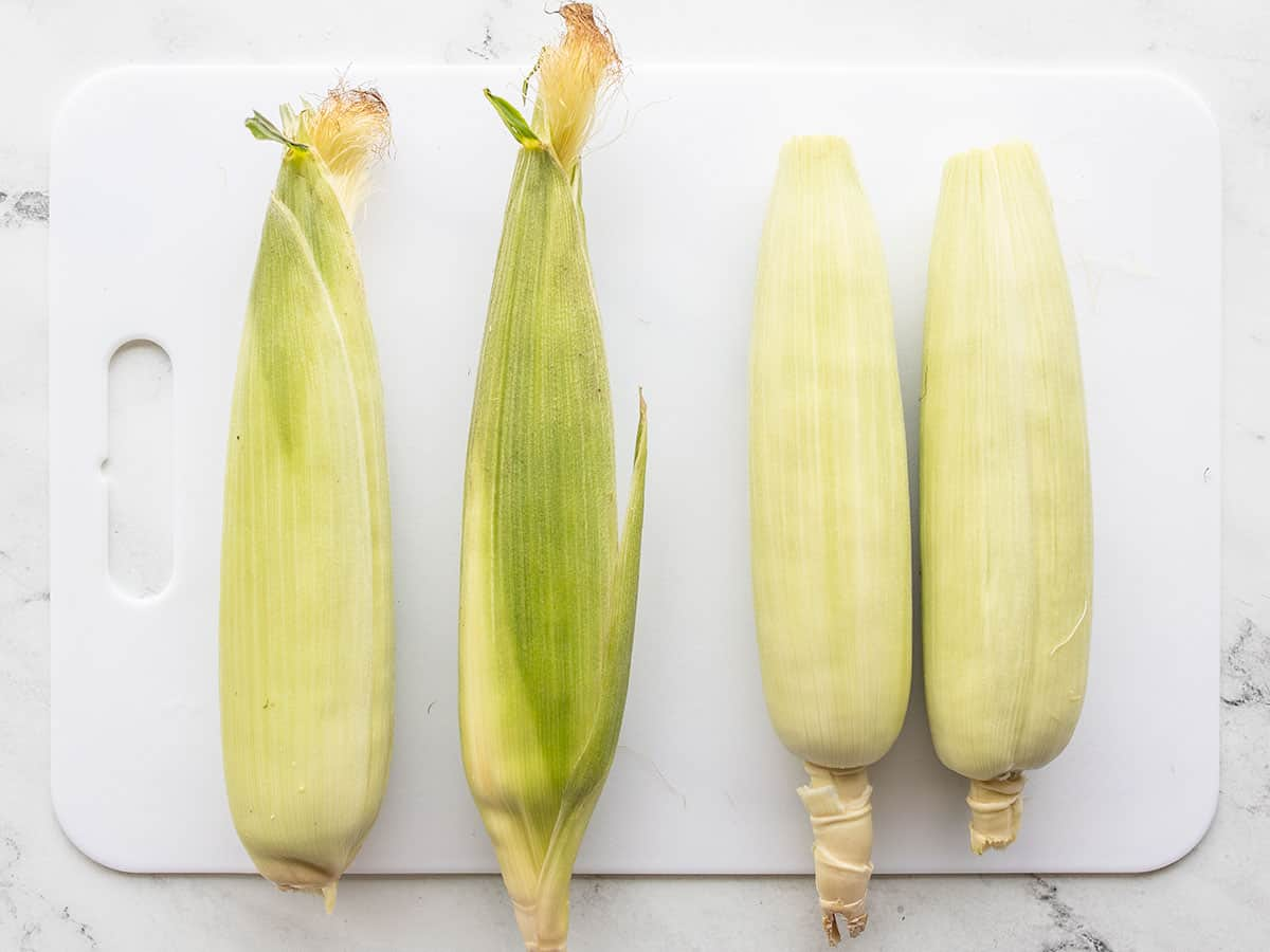Four fresh ears of corn, two prepped