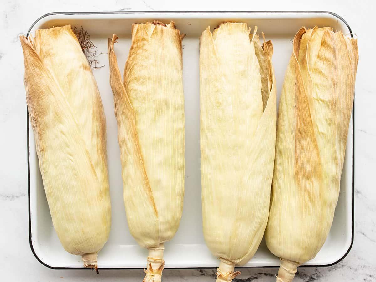 Roasted corn on a tray