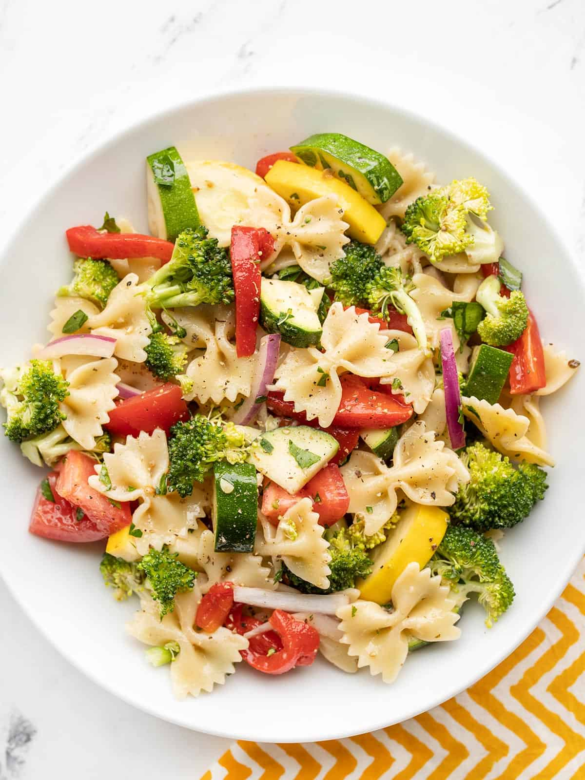 Overhead view of a bowl full of summer vegetable pasta salad