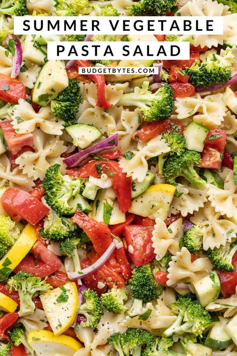 close up of summer vegetable pasta salad with title text at the top