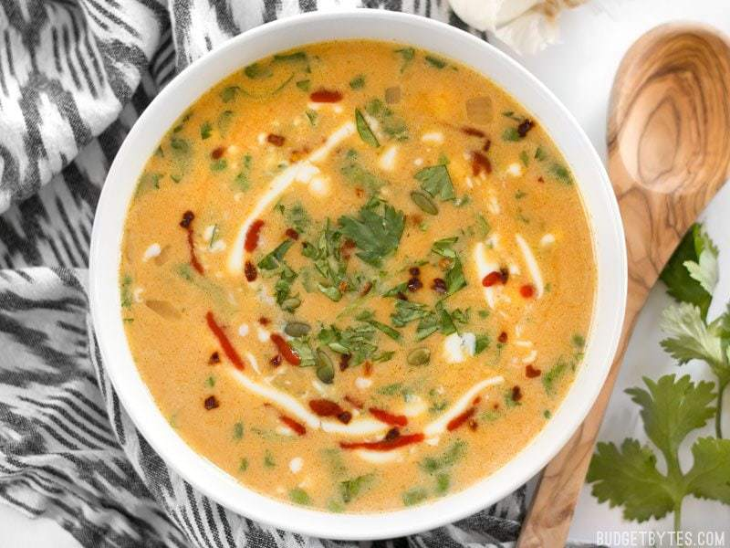 This Spicy Coconut and Pumpkin Soup is perfectly balanced with creamy coconut milk, spicy red pepper flakes and pumpkin's natural subtle sweetness. BudgetBytes.com