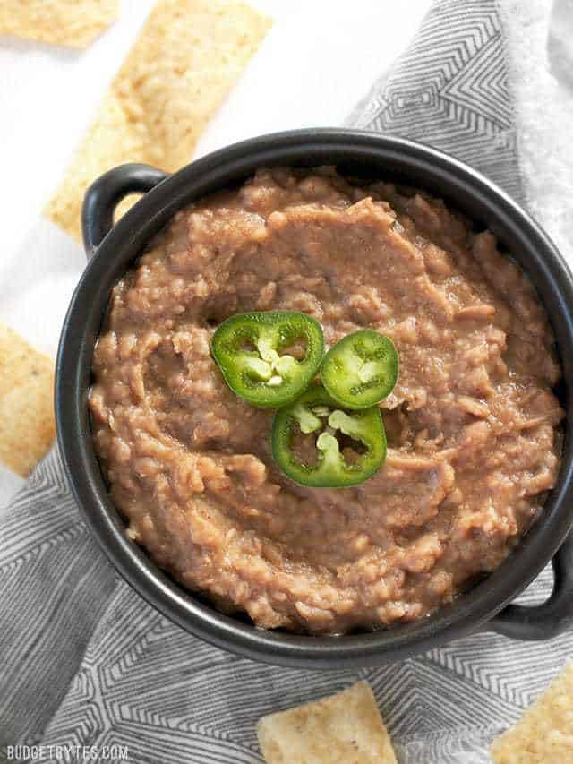 A bowl full of slow cooker (not) Refried Beans ready for dipping.