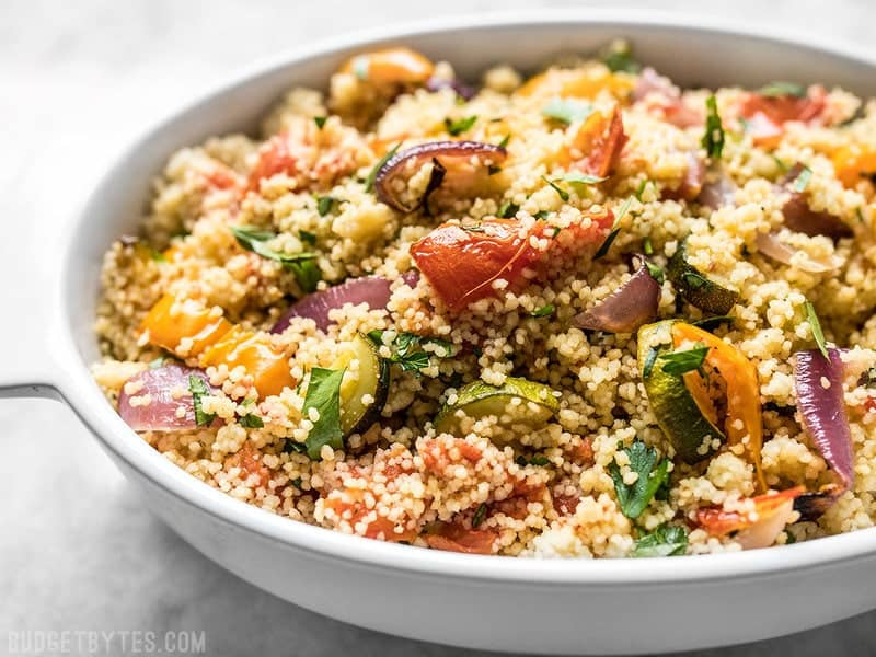 Side view of a casserole dish with Roasted Vegetable Couscous