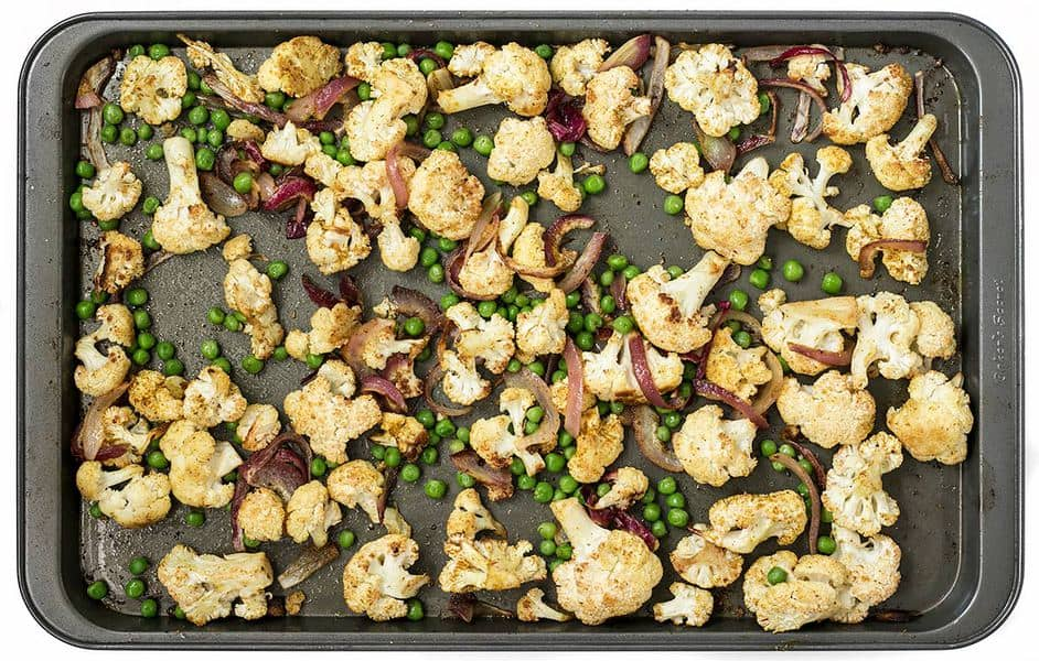 Add big flavor to plain cauliflower with this simple yet delicious Curry Roasted Cauliflower recipe. BudgetBytes.com